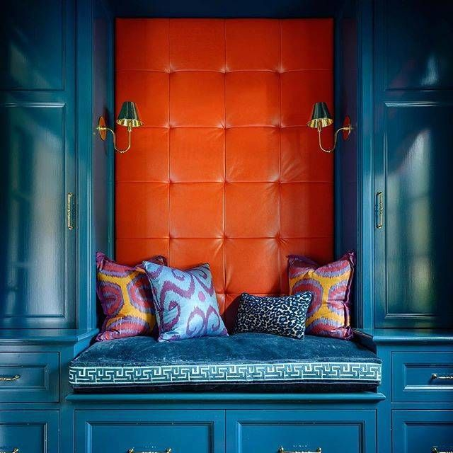 Seriously saturated shades of peacock blue & mandarin orange mingle with ikat prints to create this inviting nook