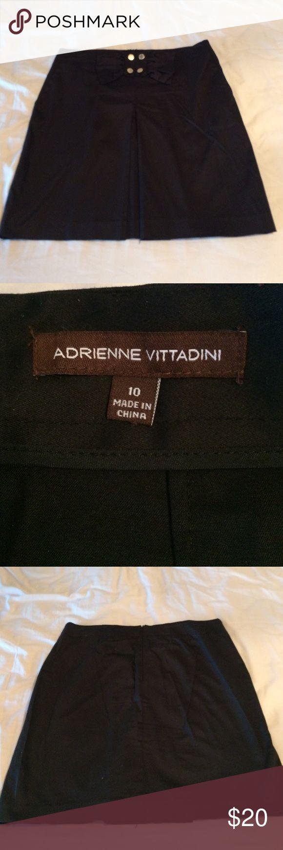 Adrienne vittadini size 10 black skirt Cute Adrienne Vittadini black skirt with gold hardware.   Machine wash cold.  Size 10 new without tag. Adrienne Vittadini Skirts Midi