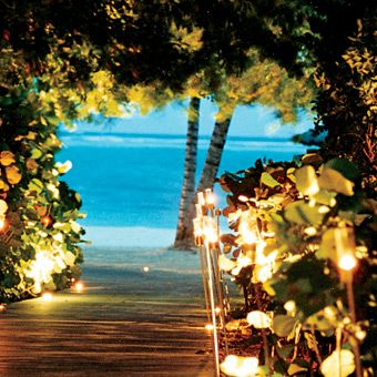 Love the tiki lights and wooden path to the beach