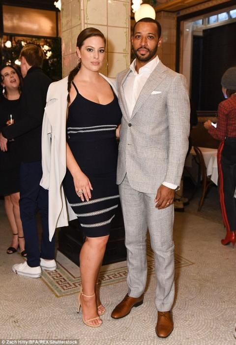 Busty Ashley Graham shows off her ample curves in clinging black dress as she and husband Justin Ervin attend CDFA Vogue bash