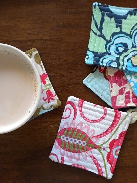 I like this fabric coaster tutorial.  Great pictures and clear instructions.