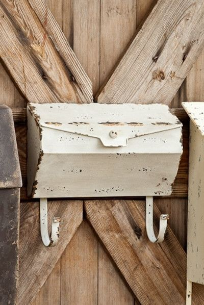 """White Metal Distressed Mailbox-Mail. Paperwork. Catalogs. Magazines. Indoor. Outdoor. Whatever the use.....wherever the display, our farmhouse mailbox collection will knock your socks off.White Farmhouse Mailbox measures12.25"""" x 4"""" x 11.5"""""""