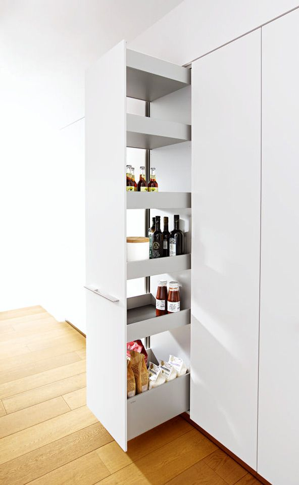 bulthaup b3 tall pull-out larder with adjustable aluminium shelves.