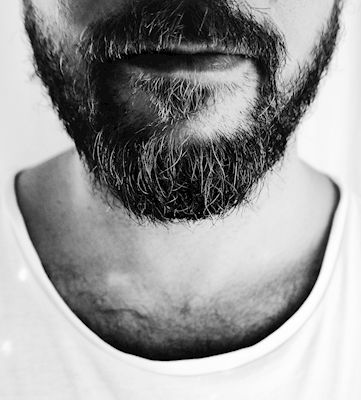 Black and white close up portrait of a man with a beard. Available at printler.com, the marketplace for photo art. Photographer Emelie Färninger