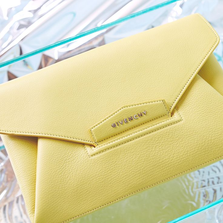 A Givenchy clutch in bright yellow is a surefire way to brighten up your cloudy days.