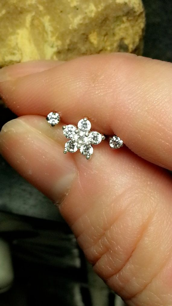 PLEASE READ REFUND/RETURN POLICY BELOW BEFORE YOU PURCHASE This listing is for a set of 3 (2 side studs and one clear CZ flower stud) STUNNING