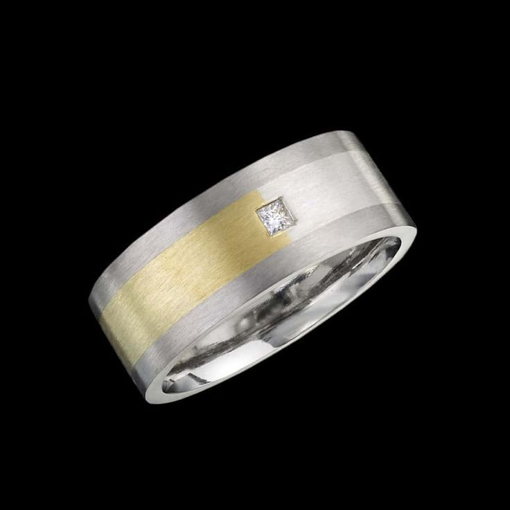 A modern ring design by Adam Neeley.  Uno ring is distinctive and sophisticated. This unique men's ring design features a band of Spectra gold, a seamless gradient ranging from rich yellow gold to cool white gold. Set within 14kt white gold.