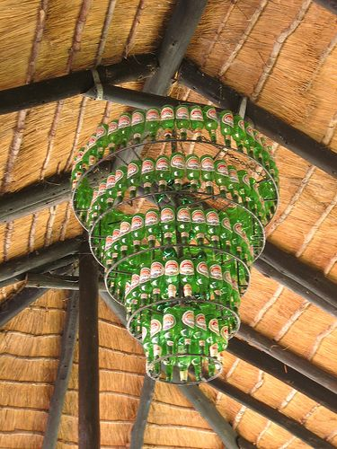 Beer bottle chandelier....different label for each layer? Bring in some color.