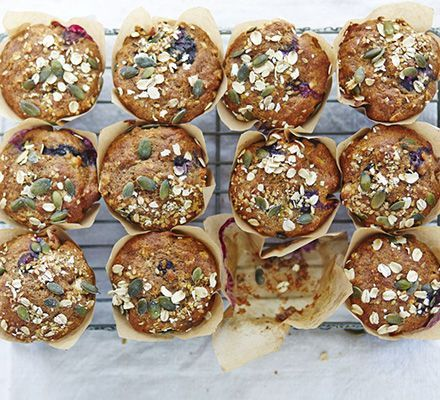 Make muffins healthier with mashed banana and apple sauce for natural sweetness, plus blueberries and seeds for an extra nutritious hit