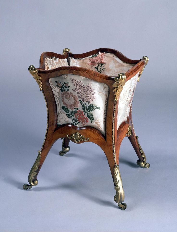 Title:  Waste-Paper Basket  Place of creation: Russia  Date: 1840s  School: St Petersburg  Material: rosewood, bronze and damask  Technique:  cast, chased, engraved and turner's work  Dimensions:  46,5x40x40 cm