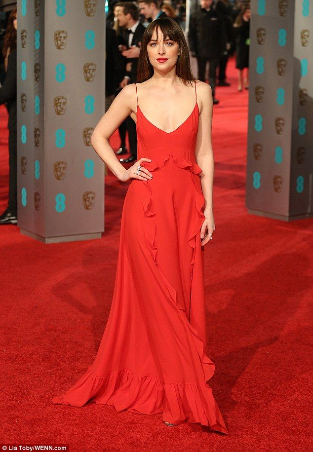 Wowing them: Dakota Johnson, 26, wasn't afraid to show some skin on the 2016 BAFTAs red carpet at London's Royal Opera House on Sunday