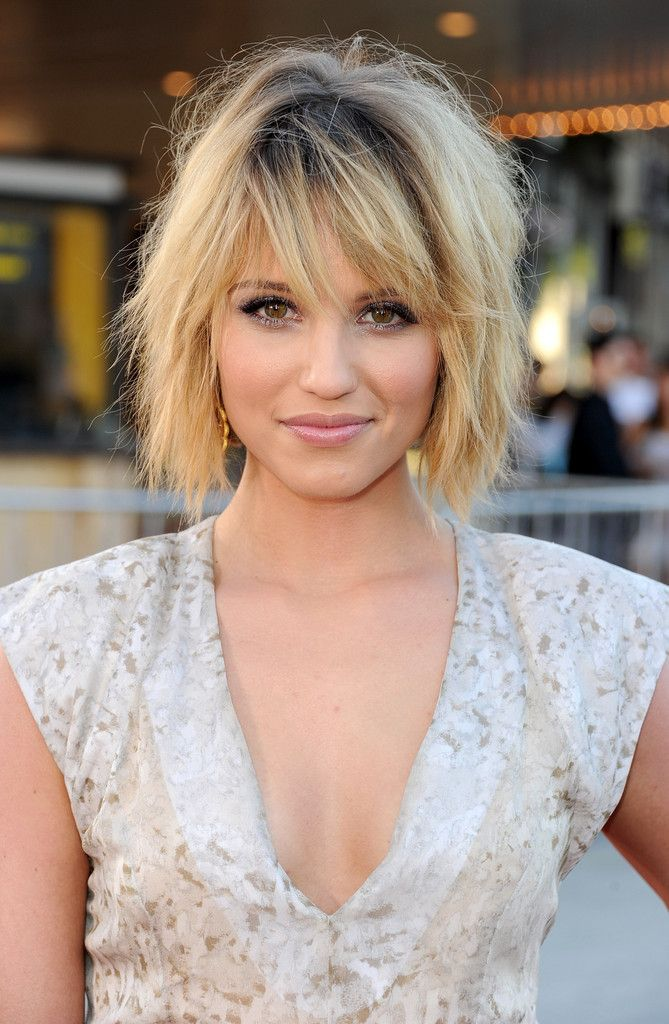 tousled layered bob with dark roots and razor-cut side-swept bangs