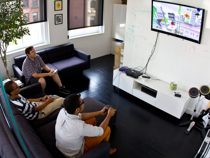 fun in the office. in a sleek soho office squarespace is trying to redefine web design fun the