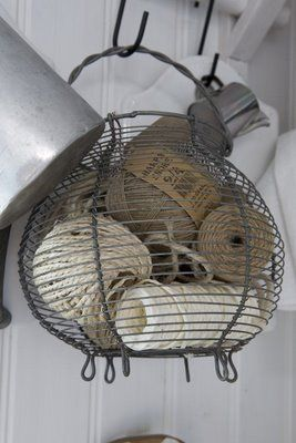Old egg basket as storage for string & twine. Great way to repurpose an egg basket for those of us who don't gather eggs on a daily basis. Or ever. #kitchen #wireware #basket