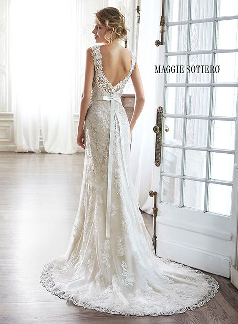Lace sheath wedding dress with dramatic V-back and Swarovski crystal grosgrain ribbon belt, Pia by Maggie Sottero.