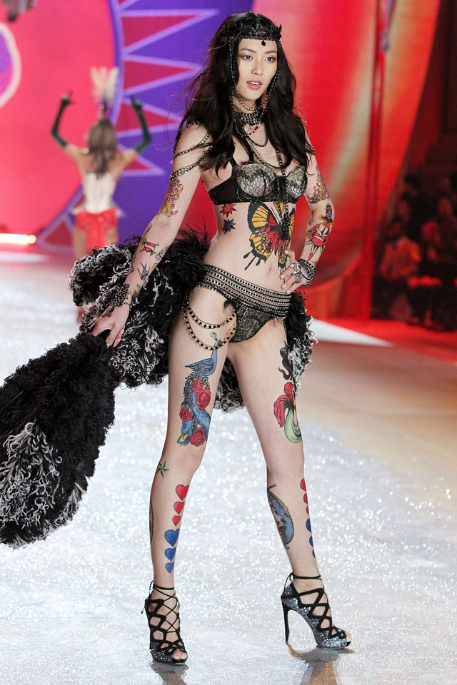 Step right up and see Liu Wen, the sexiest tattoo lady in history.