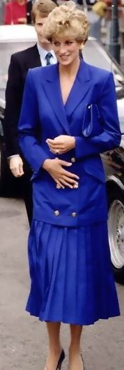 electric blue jacket with pleated skirt