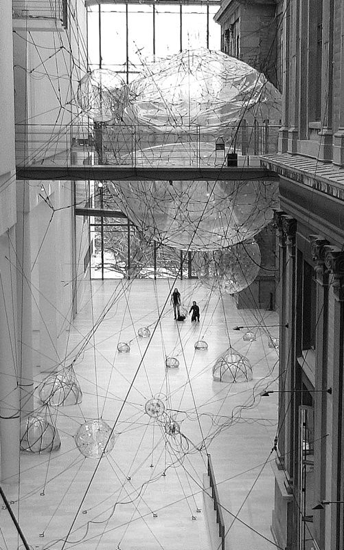This is a picture from the new exhibit at the National Danish Museum of Art in Copenhagen. It is an artist's rendering of what they Think we maybe be living in the future. People can go inside the largest of the plastic bubbles