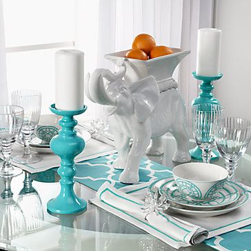 Aqua and white. I think the color combo would help brighten the grey in the room.