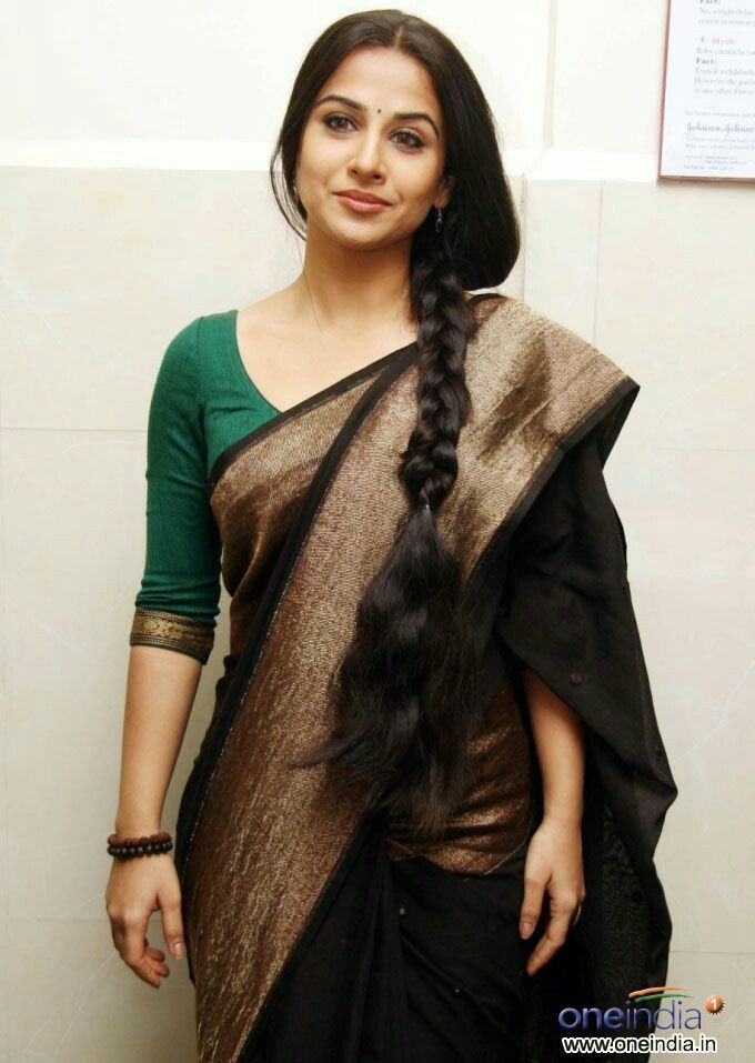 The golden hue with black and the contrasting green blouse is just  #vidyabalan