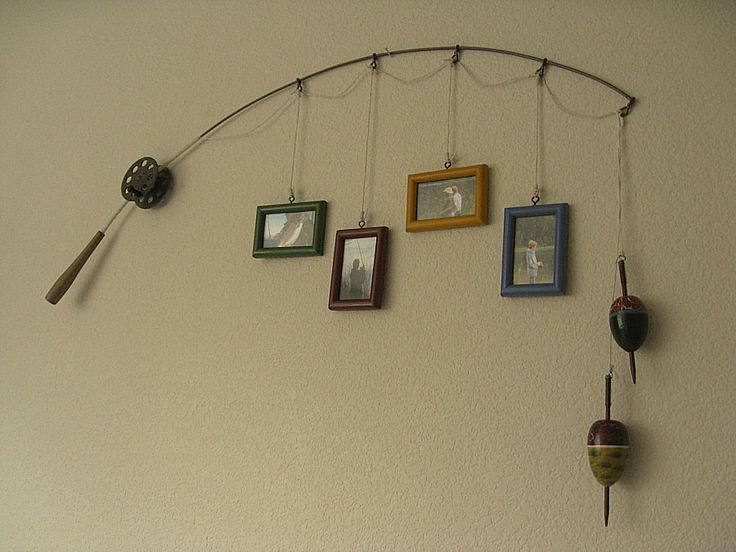 Fishing pole picture frame - this is not something I would do for myself and my home decor but it is soo cute I think it would look great at the lake house or you could do bright frames and a kiddy pole for the boys room