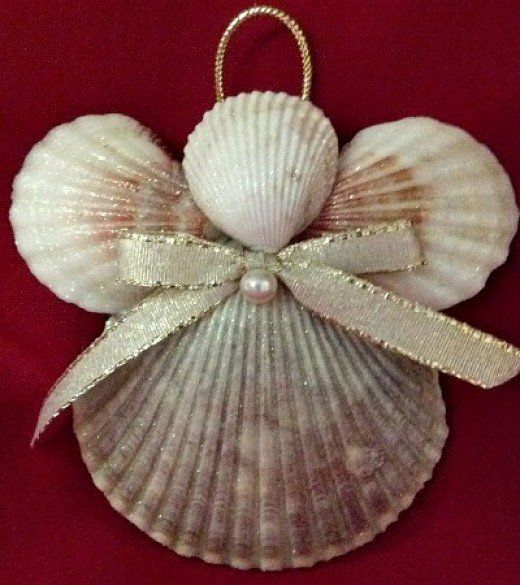 A little spray adhesive glitter, a little glue, a pretty bow and a faux pearl make a pretty pink seashell angel Christmas ornament.