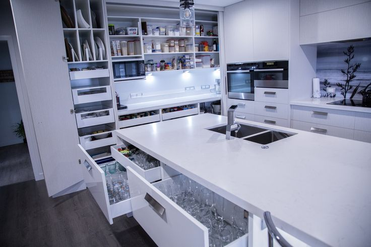 Powell kitchen featuring island in Caesarstone Frosty Carrina and cabinetry in Melteca Alaska in Puregrian finish