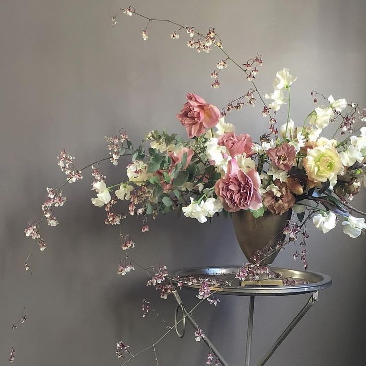 How pretty are these ruffly pink garden roses and the delicate spray orchids!
