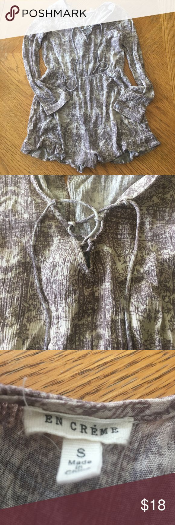 Lavender and cream long sleeved romper Small lavender and cream colored romper. Absolutely adorable on. Unfortunately it's too small for me. Only worn twice. Definitely a romper but I wasn't sure how to tag it - couldn't see a tag for romper. en creme Dresses Mini