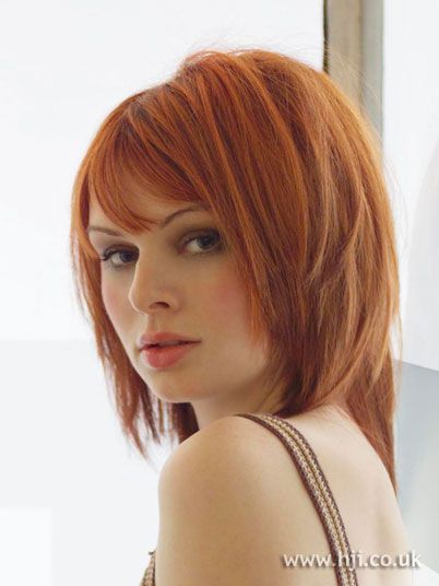 2006 red straight hairstyle. Red hair was cut into a mid length bob and
