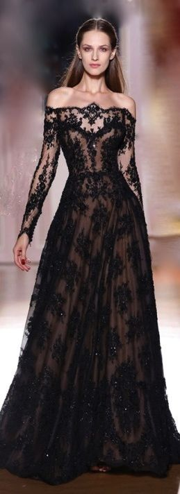 This is just... ugh. Oh man, black lace, over what looks like a nude under skirt.. LOVE. So elegant in a dark, mysterious way. LOVE. Would make a cool black wedding dress!