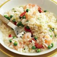 I had a delicious spring pea risotto with lobster at Ed's Chowder House last night. I'm going to use this recipe as a base to make a home version of it. Additions I'll steal from Ed's recipe: fresh fava beans and some chopped chives.