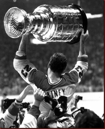 Conn Smythe Trophy winner, Bob Gainey, is hoisted on his teammates' shoulders as he raises the Stanley Cup, May 21, 1979. The Canadiens defeated the Rangers in five games.