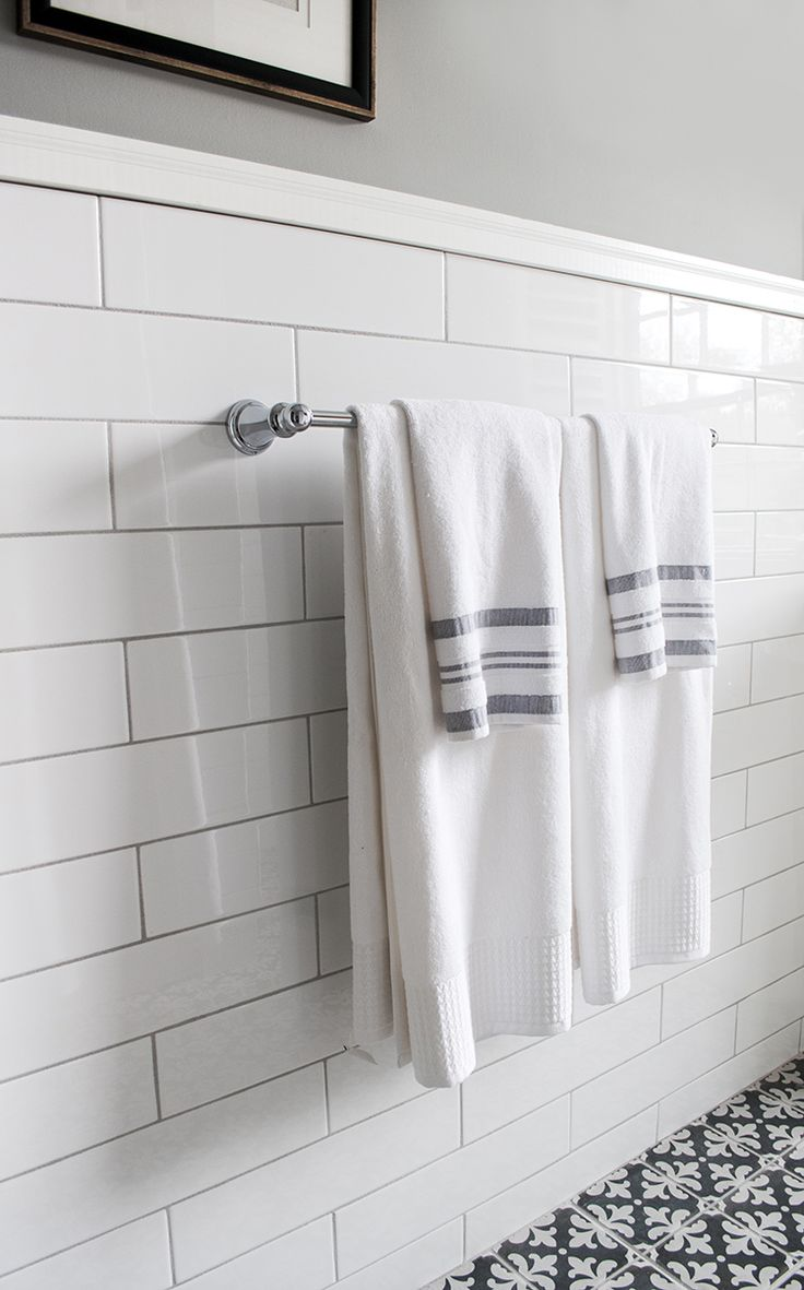 oversized subway tile with gray grout, no skirting, top ...