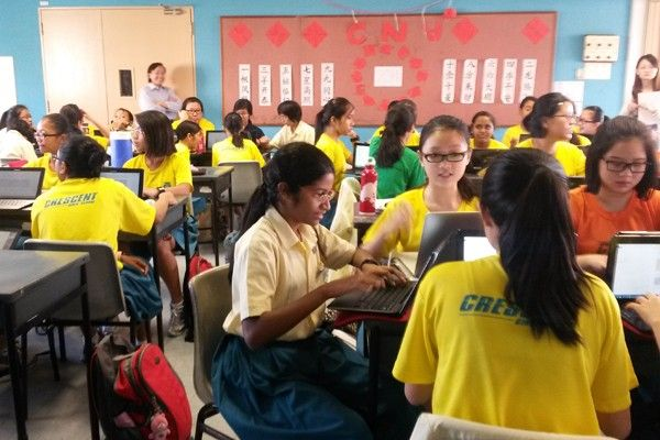 SINGAPORE—Forty students in bright yellow shirts hunched over their computers in Singapore's Crescent Girls School as they raced against their teacher's digital stopwatch. They had just a few minutes to add their thoughts about a short film on discrimination into a shared Google Doc and browse the opinions of their classmates. When the time was …