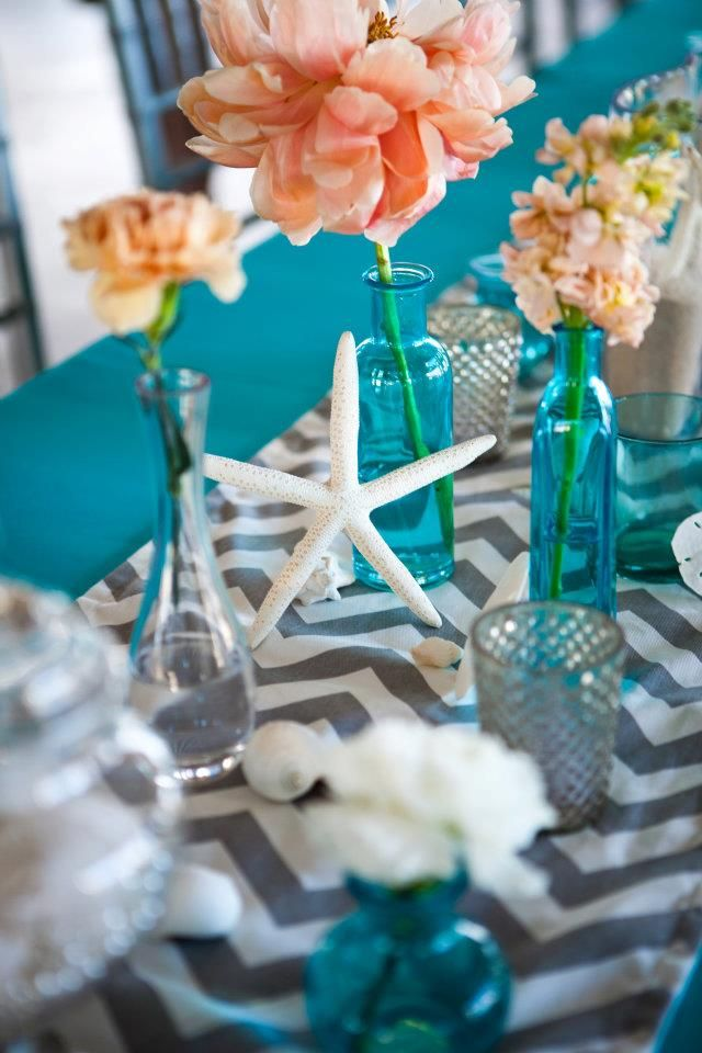 Love the blue colored bases, maybe w a yellow chevron table runner and white flowers in vase? Beach wedding with @Wendy Felts Felts Felts Felts Wilson Photography, @Dana Curtis Curtis Curtis Curtis Goodman, @Sherrie Bowe-Hernandez Bowe-Hernandez Bowe-Hernandez Bowe-Hernandez Mullis, @Rachel Rowell, and @Elizabeth Lockhart Lockhart Lockhart Lockhart Baldwin Smith