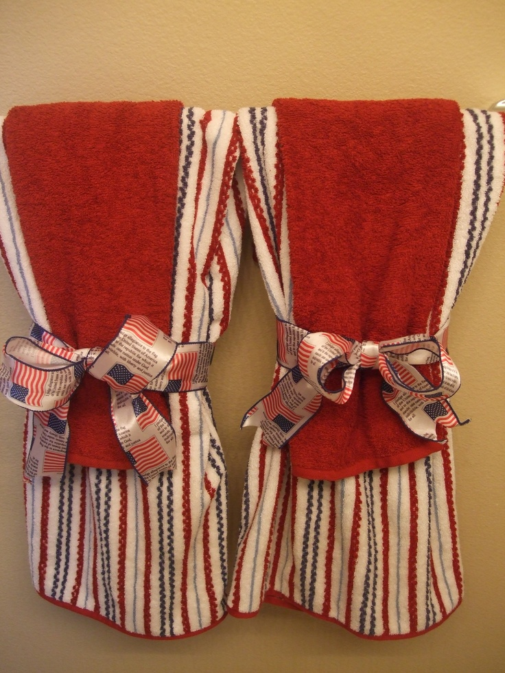 I totally re-decorated my kids bathroom into an Americana bathroom. I LOVE IT!!! Here are my cool towels tied with the pledge of allegiance ribbon.