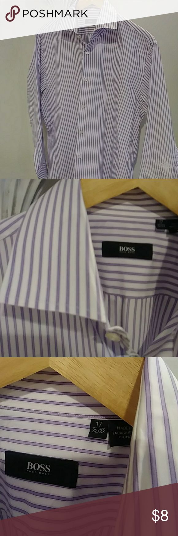 Hogo Boss 17-32/33 Is a nice Hugo Boss shirt that's white with lilac stripes. However the shirt has one issue, the last three pictures show a patch inside the left sleeve and the last two pictures shows outside of the shirt. Hugo Boss Shirts Dress Shirts
