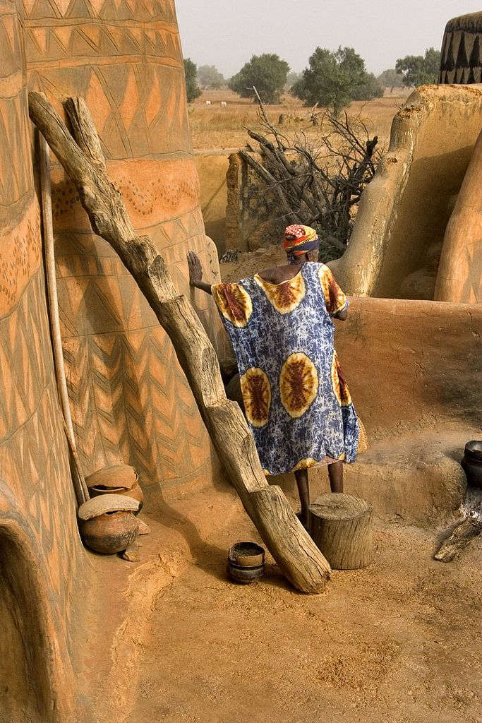 Tiebele Woman on the roof of a traditional mud house in Burkina Faso
