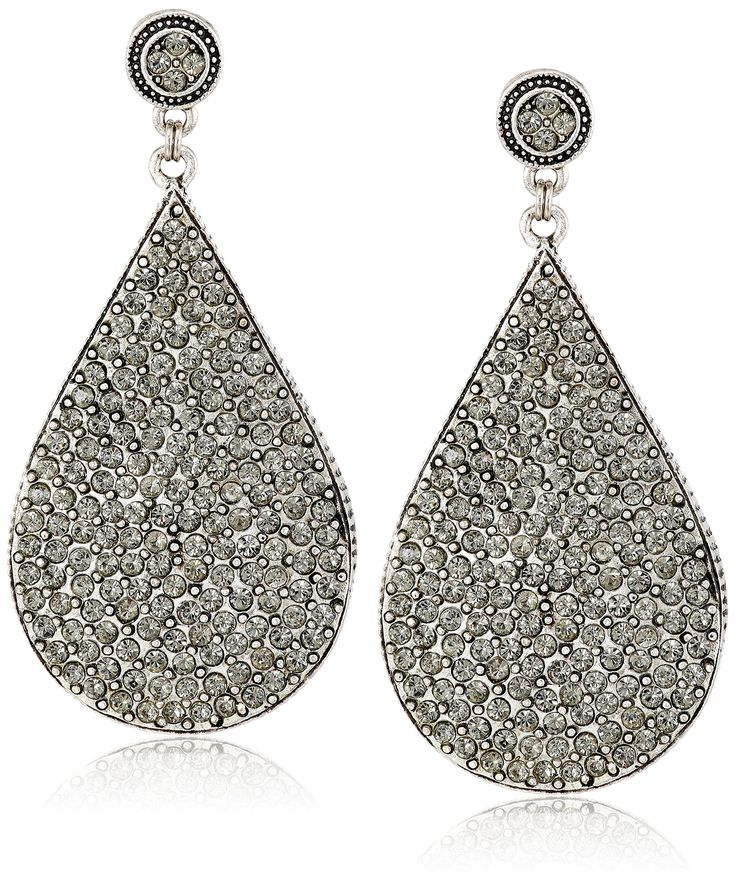 Azaara Crystal Black Swarovski Crystal Teardrop Earrings. Statement earrings featuring large teardrops studded with black Swarovski crystals. Friction-back post. The natural properties and composition of mined gemstones define the unique beauty of each piece. The image may show slight differences to the actual stone in color and texture. Clean with dry polishing cloth. Domestic.
