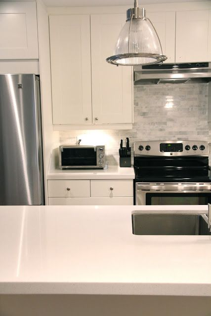 Love the backsplash tile and the white ikea cabinets for Adel kitchen cabinets ikea