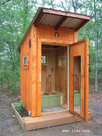 If you need an outhouse, why not make it beautiful? This one has has beaded paneling, stained glass, and power. It's also bug and critter-proof. | Tiny Homes