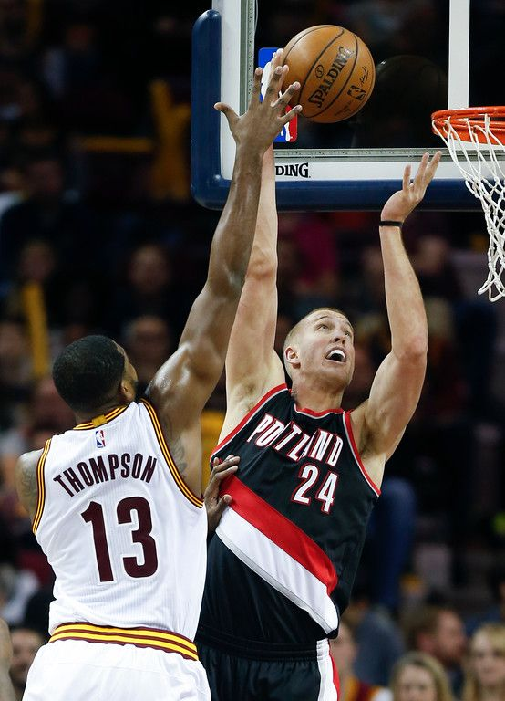 Portland Trail Blazers' Mason Plumlee scores against Cleveland Cavaliers'  Tristan Thompson during the first half of an NBA basketball game,  Wednesday, ...