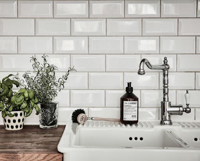 subway tiles - wood counter - butler sink