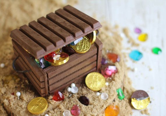 Candy jewels and chocolate coins fill this DIY edible treasure chest.