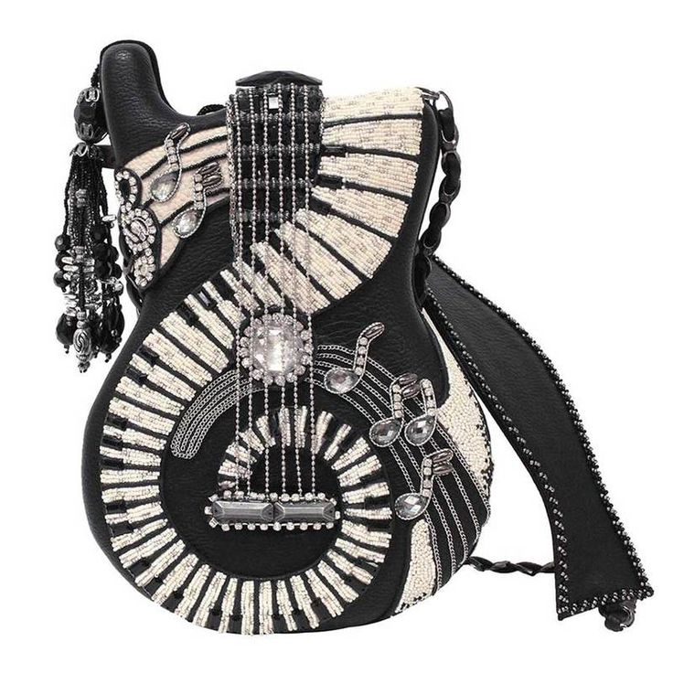 "Ladies """"Jammin"""" guitar shaped handmade handbag. Black and white music inspired design. Embelished with beads and rhinstones. Single snap button flap closure. Inside of bag features open middle with"