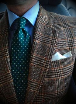That neck tie is SO nice. I kinda' like the jacket too, but the tie is the star here. Love that colour/pattern combo.