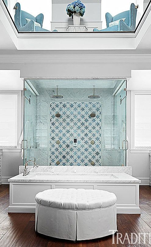 Giuliana and Bill Rancic are famous for their dedication to his hometown, Chicago. Giuliana and Bill have a two-story bathroom and dressing room. The spaces are unified by teal Bernhardt chairs on the upper floor and matching Walker Zanger tiles below.