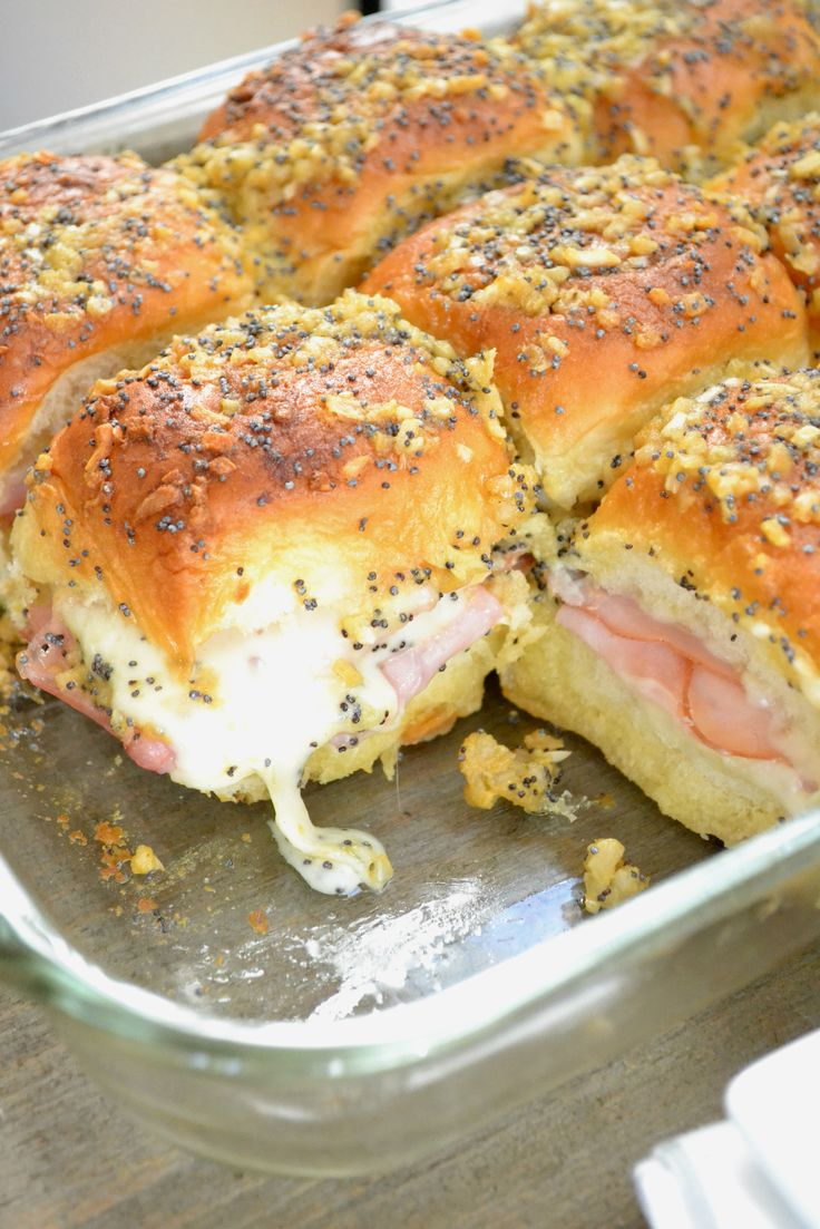 A fast and easy recipe for Ham and Swiss Sliders that are a must-have for any game day party!