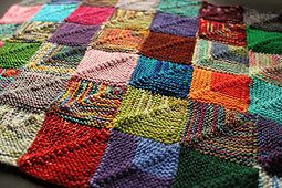 Use leftover yarn to make a square and save it. When you have collected enough squares, stitch them together to make a blanket.